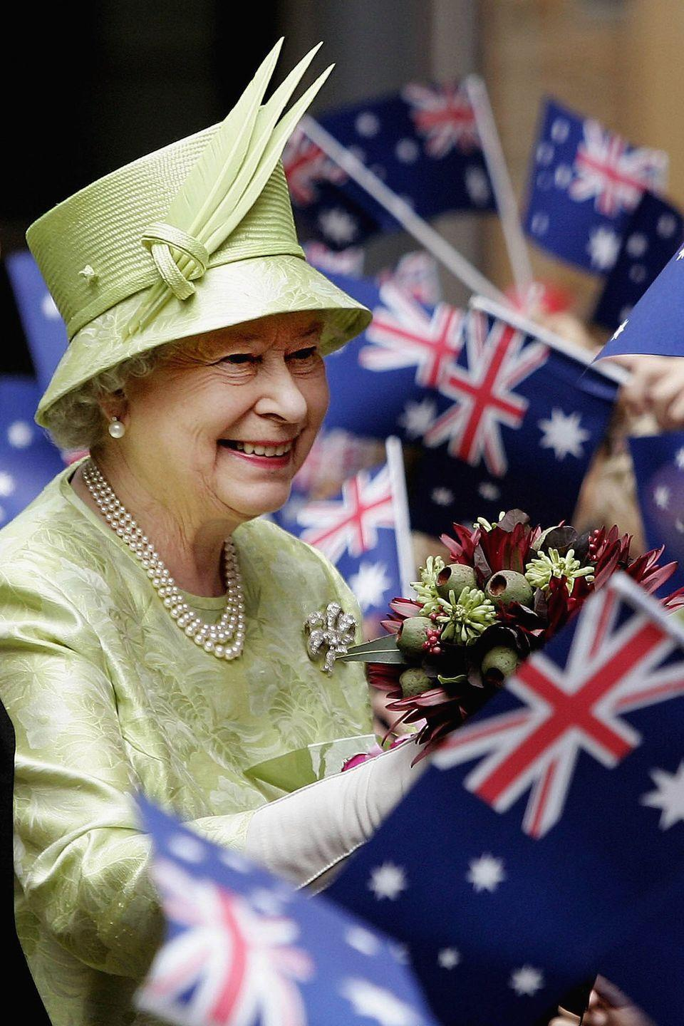 <p>The large crowd waving Australian flags greeted Queen Elizabeth after a Commonwealth Day Service. At the time, she and her husband were on a five-day long trip to Australia where she opened up the Commonwealth Games in Melbourne.</p>