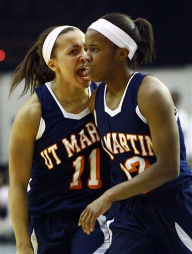 Tennessee Martin guard Heather Butler (11) yells at teammate Jasmine Newsome (12) after she hit the game-tying basket to send the game into overtime during the championship game in the Ohio Valley Conference NCAA college basketball tournament on Saturday, March 9, 2013, in Nashville, Tenn. Tennessee Martin won 87-80 in overtime for their third consecutive championship. (AP Photo/Wade Payne)