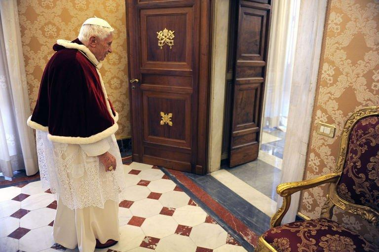 Pope Benedict XVI walks into his private library at the Vatican on February 15, 2013. On Saturday, Vatican spokesman Federico Lombardi said that once Benedict steps down, he will stay in the papal summer seat in Castel Gandolfo near Rome for around two months before moving to a monastery within the Vatican walls