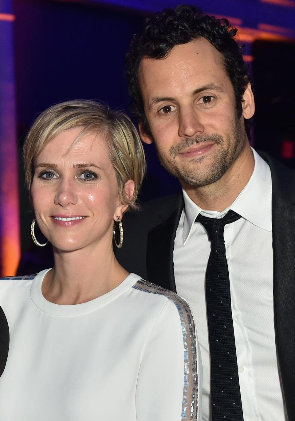 """<p>After <a href=""""https://www.popsugar.com/celebrity/kristen-wiig-fiancé-avi-rothman-welcome-twins-47557355"""" class=""""link rapid-noclick-resp"""" rel=""""nofollow noopener"""" target=""""_blank"""" data-ylk=""""slk:welcoming twins in 2020"""">welcoming twins in 2020</a>, Kristen confirmed during a February 2021 appearance on <strong>The Howard Stern Show</strong> that <a href=""""https://www.usmagazine.com/celebrity-news/news/kristen-wiig-confirms-she-married-avi-rothman-calls-him-husband/"""" class=""""link rapid-noclick-resp"""" rel=""""nofollow noopener"""" target=""""_blank"""" data-ylk=""""slk:she and her longtime love had secretly tied the knot"""">she and her longtime love had secretly tied the knot</a>. """"Besides the fact that we are where we are - it's hard to not feel so much of the sh*t and struggle that's going on,"""" Kristen said. """"In my home, I'm very lucky about having these two babies and my husband. They make it all better. It's changed my life.""""</p>"""