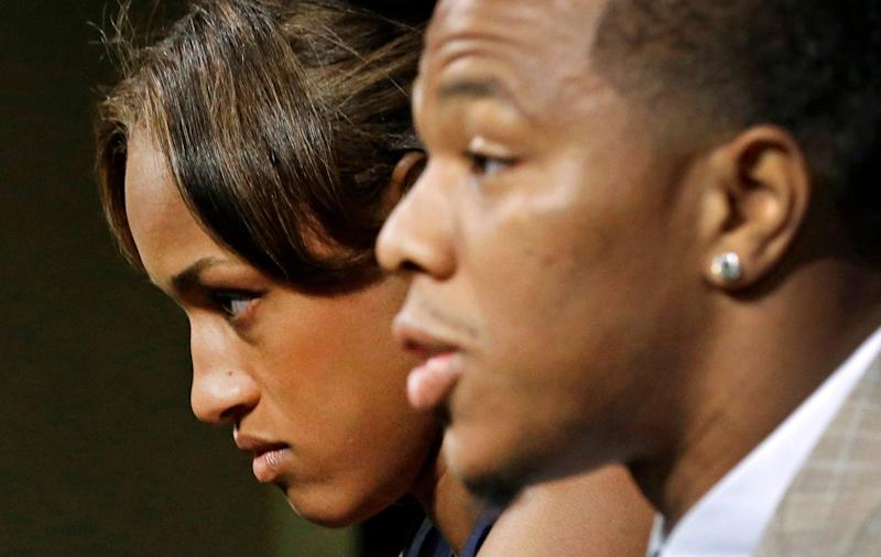Janay Rice, left, looks on as her husband, Baltimore Ravens running back Ray Rice, speaks to the media during a news conference in Owings Mills, Md.