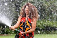 <p>Winner of the 2021 Australian Open Naomi Osaka sprays champagne during a photo shoot at the Government House in Melbourne on Sunday.</p>
