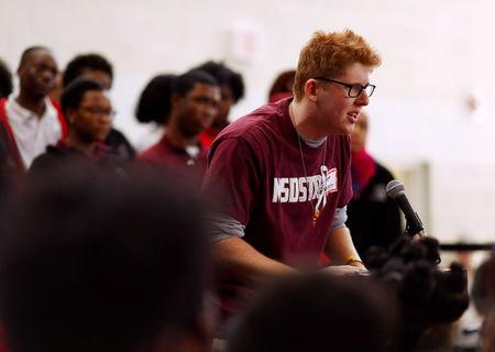 FILE PHOTO: Matt Deitsch, an alumni of Marjory Stoneman Douglas High School, speaks during a rally with Thurgood Marshall Academy students in advance of Saturday's March for Our Lives event in Washington, U.S. March 22, 2018. REUTERS/Eric Thayer/File Photo