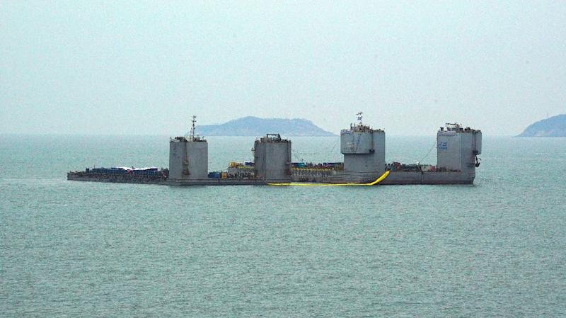 Barges during a salvage project to bring the sunken Sewol ferry back to surface in the sea off the southwestern island of Jindo