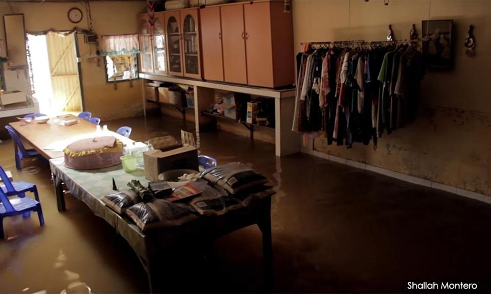 The inside of one of the homes of the women after a flood from 'Women of The Forest', a documentary of the Arrow research