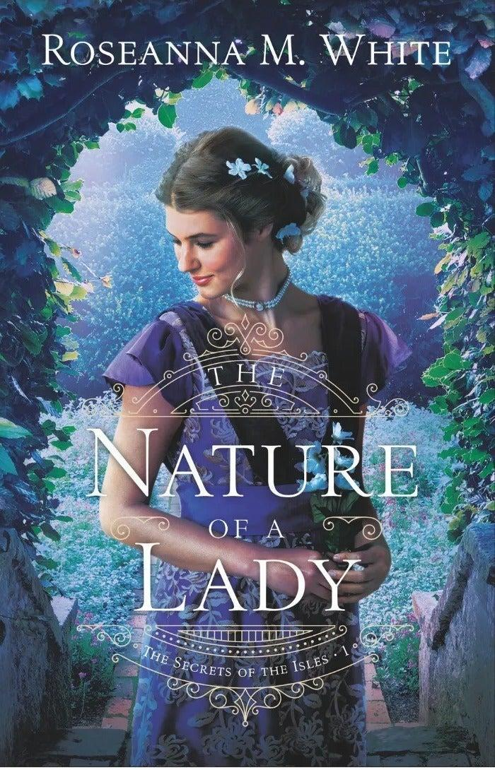 """While the front cover of this book might look like something you'd find in a retirement home, the content is cottagecore in a nutshell. <br><br>Set in 1906, the story follows Lady """"Libby"""" Sinclair as she flees to the Isles of Scilly for the summer to avoid the judgment of her high society peers. As a lover of the natural world, Libby hopes to spend the summer exploring the landscape with her microscope. However, once she arrives, she learns that the woman named Beth who previously occupied the holiday cottage has vanished without a trace. Teaming up with Beth's brother to help solve the mystery, the pair search the islands in hope of finding answers, local legends and a whole lot of love along the way. <br><br><strong>Roseanna M White</strong> The Nature of a Lady, $, available at <a href=""""https://uk.bookshop.org/books/the-nature-of-a-lady/9780764237188"""" rel=""""nofollow noopener"""" target=""""_blank"""" data-ylk=""""slk:bookshop.org"""" class=""""link rapid-noclick-resp"""">bookshop.org</a>"""