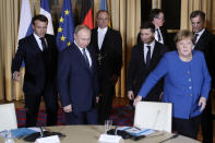French President Emmanuel Macron, second left, Russian President Vladimir Putin, left, German Chancellor Angela Merkel and Ukrainian President Volodymyr Zelenskiy,second right, arrive for a working session at the Elysee Palace Monday, Dec. 9, 2019 in Paris. Russian President Vladimir Putin and Ukraine's president are meeting for the first time at a summit in Paris to find a way to end the five years of fighting in eastern Ukraine. (AP Photo/Thibault Camus, Pool)