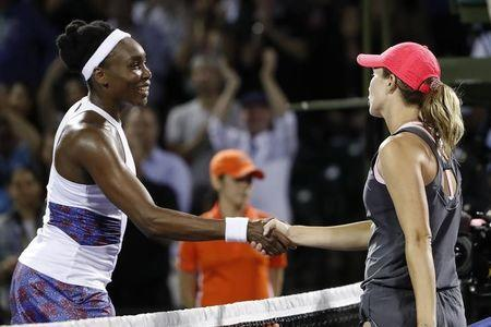 Danielle Collins of the United States shakes hands with Venus Williams of the United States (L) after their match on day nine at the Miami Open at Tennis Center at Crandon Park. Colins won 6-2, 6-3. Mandatory Credit: Geoff Burke-USA TODAY Sports
