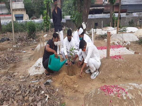 Hanif (second from left) planting a sapling at a Lucknow graveyard (ANI).