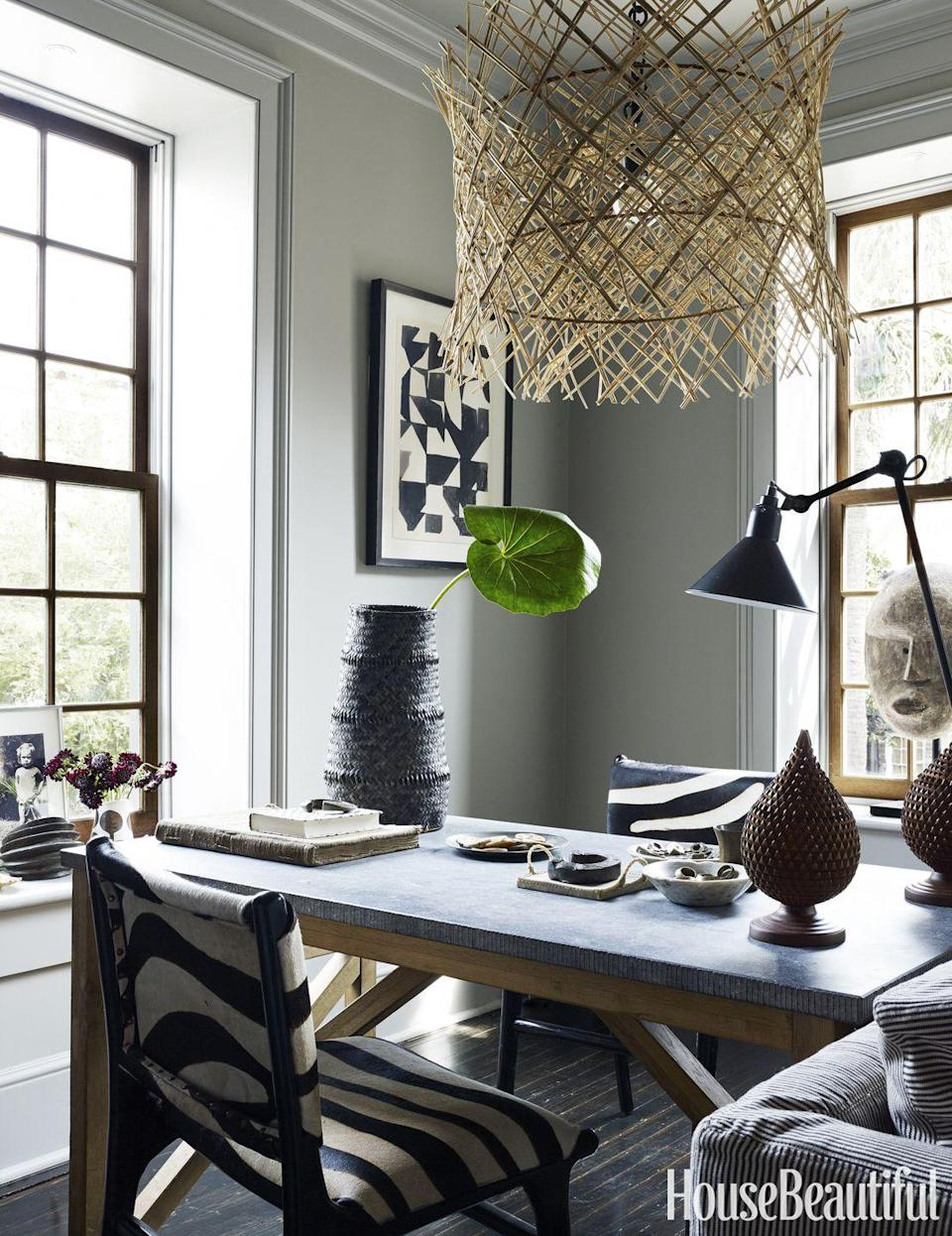"""<p>To totally transport yourself somewhere way more exciting than your work, try an bold pattern, like the black-and-white zebra motif in this <a href=""""https://www.housebeautiful.com/design-inspiration/house-tours/g3558/jill-sharp-weeks-charleston-rental-tour """" rel=""""nofollow noopener"""" target=""""_blank"""" data-ylk=""""slk:Charleston home office"""" class=""""link rapid-noclick-resp"""">Charleston home office</a>. A rattan chandelier adds texture.</p>"""