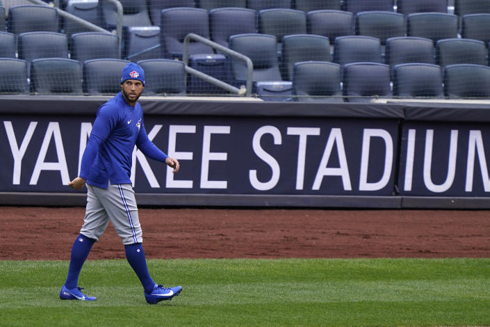 Toronto Blue Jays center fielder George Springer (4) walks on the field during a team workout, Wednesday, March 31, 2021, at Yankee Stadium in New York. The Blue Jays face the New York Yankees on opening day Thursday in New York. (AP Photo/Kathy Willens)