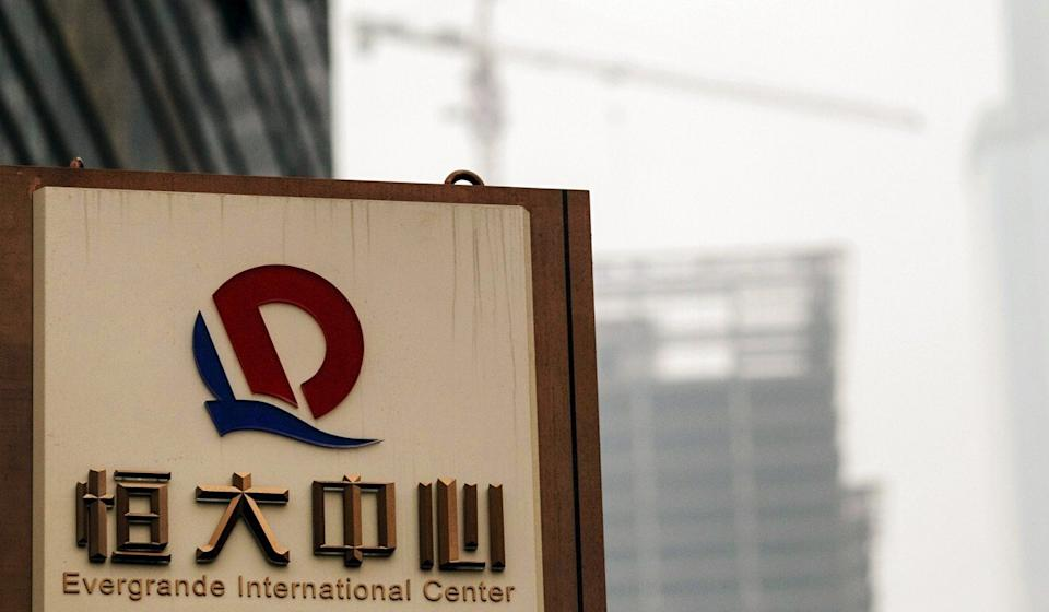 A logo of Evergrande Group is seen in front of a construction site in Guangzhou, Guangdong province, in this 2014 file photo. Photo: Reuters