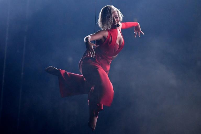 Doja Cat took a break from hosting duties for an aerial performance in a sultry red get-up (AFP/ANGELA WEISS)