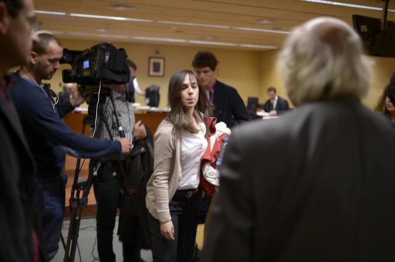 Pianist Laia Martin, center, leaves the courtroom in Girona, Spain, Friday, Nov.15, 2013. To most people, noise pollution is a jet engine roaring over their head. For one Spanish woman, it was a neighbor playing the piano more softly than a spoken conversation. The woman has taken her neighbors in the apartment below, 27-year-old pianist Laia Martin and her parents, to court. Now prosecutors want to send all three to jail for over seven years on charges of psychological damage and noise pollution. In a country known for its exuberant noisiness, the case has raised eyebrows. A Catalonia Justice Tribunal spokeswoman said the trial will end Nov. 15 with the verdict issued at a later date. (AP Photo/Manu Fernandez)