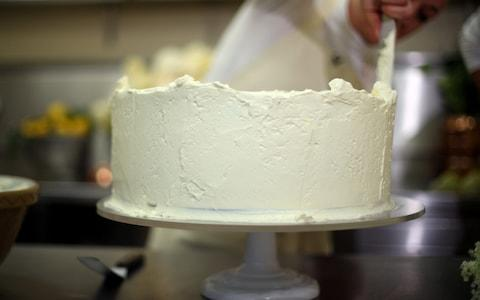 Claire Ptak puts finishing touches on the cake - Credit: Hannah McKay