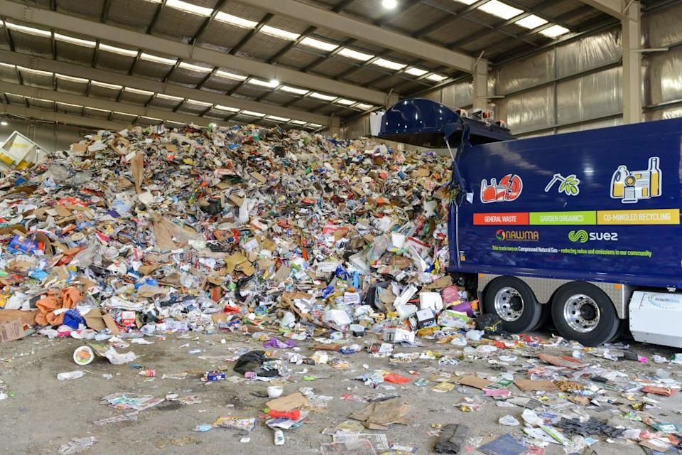 This photo taken on April 17, 2019 shows household recycled items being delivered ready for separation in Adelaide. Source: Getty