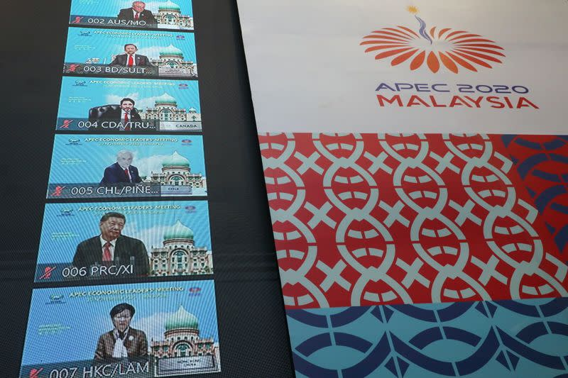 FILE PHOTO: Participants of the virtual APEC Economic Leaders Meeting 2020 are seen on a screen, in Kuala Lumpur