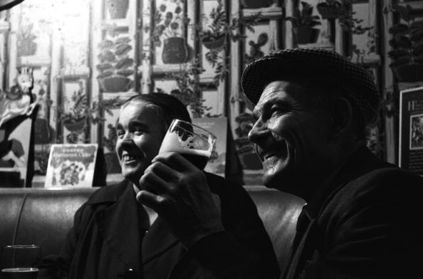 <p>Customers relax with a few drinks at the Jolly Gardeners Pub on Union Street in London. The city boasts more than 3,500 pub options.</p>