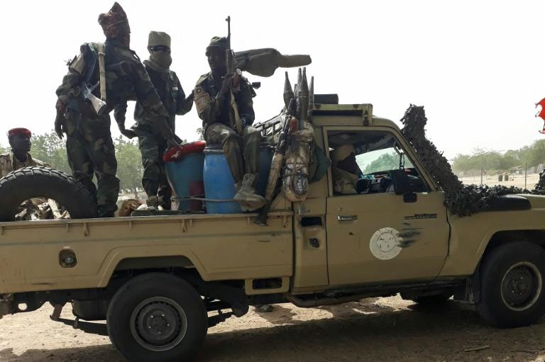 The Chad troops riding pick-up trucks and tank transporters, crossed the bridge back home to N'djamena via the Cameroon border town of Kousseri under the curious gaze of locals (AFP Photo/-)