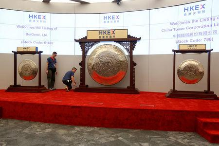 Gongs are prepared for the listing of China Tower Corporation Limited and BeiGene Ltd at the Hong Kong Exchanges in Hong Kong, China August 8, 2018.   REUTERS/Bobby Yip