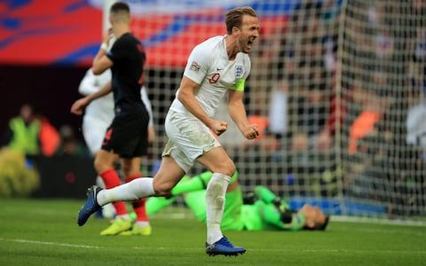 Harry Kane of England celebrates scoring the winning goal during the UEFA Nations League A group four match between England and Croatia - Credit: GETTY IMAGES