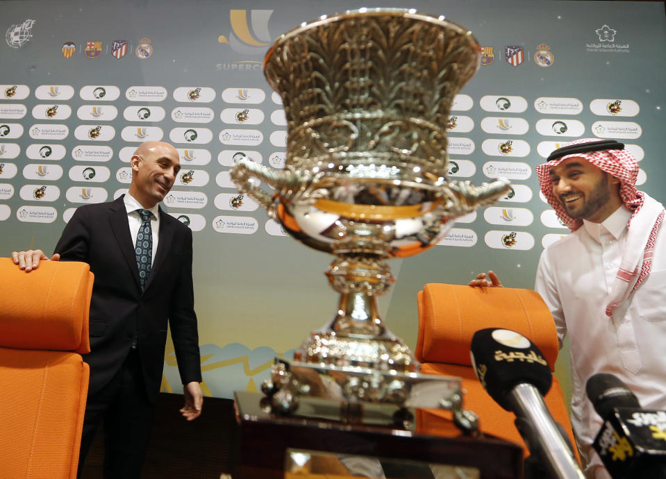 """In this Wednesday, Dec. 18, 2019 photo, President of the Spanish Soccer Federation, Luis Rubiales, left, and Prince Abdulaziz bin Turki al-Faisal, who leads the General Sports Authority, enter a press conference behind the Spanish Super Cup, to be held in Saudi Arabia in January 2020. """"Sports has been a tool for social change within the kingdom"""", the Prince said during an interview with the Associated Press. (AP Photo/Amr Nabil)"""