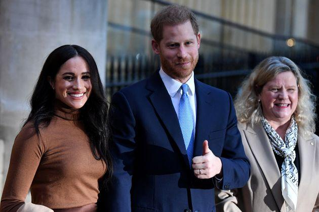 The Duke and Duchess of Sussex stand with High Commissioner for Canada in the United Kingdom Janice Charette as they leave after their visit to Canada House in London on Jan. 7, 2020.