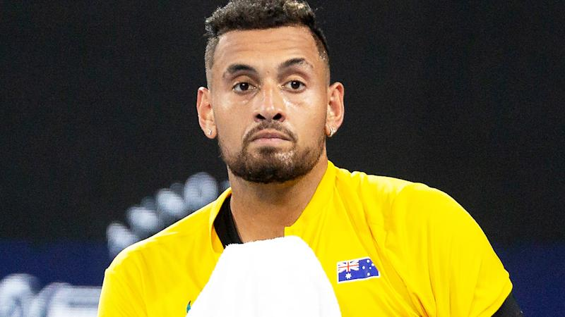 Nick Kyrgios, pictured here looking dejected during his loss at the ATP Cup.