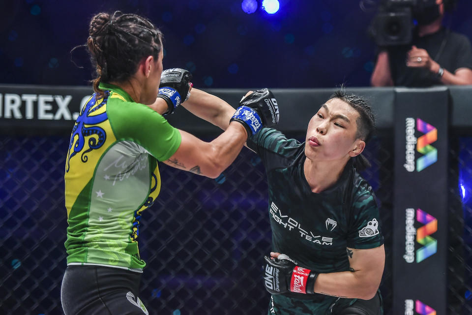 Xiong Jingnan (right) of China battles Brazil's Michelle Nicolini in their main-event bout at ONE: Empower. (PHOTO: ONE Championship)