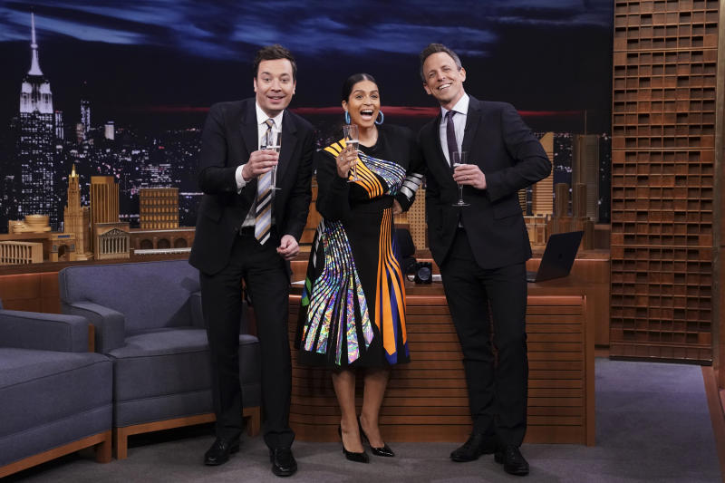 Jimmy Fallon, Lilly Singh and Seth Meyers celebrating Singh's new late-night show on Thursday. (NBC via Getty Images)