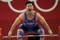 Lyu Xiaojun of China competes in the men's 81kg weightlifting event, at the 2020 Summer Olympics, Saturday, July 31, 2021, in Tokyo, Japan. (AP Photo/Luca Bruno)