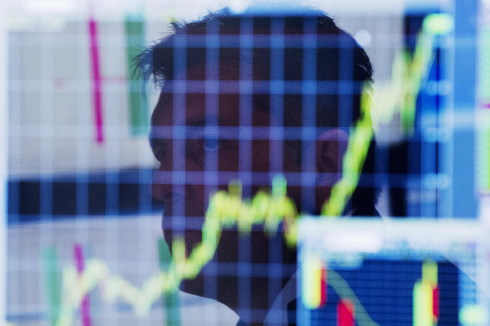 A trader looks up at a chart on his computer screen while working on the floor of the New York Stock Exchange shortly after the market opening in New York July 11, 2013. Global stock indexes rose sharply while the dollar tumbled on Thursday after Federal Reserve chief Ben Bernanke signaled the U.S. central bank may not be as close to winding down its stimulus policy as markets had begun to expect. REUTERS/Lucas Jackson (UNITED STATES - Tags: BUSINESS)