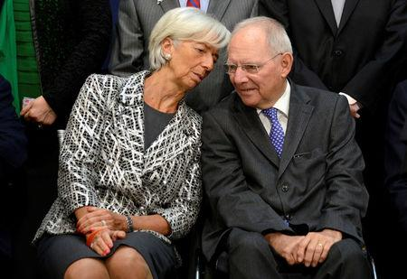 "IMF Managing Director Christine Lagarde (L) chats with German Finance Minister Wolfgang Schauble as they take their seats for a ""family"" photo for the International Monetary and Financial Committee (IMFC), as part of the IMF and World Bank's 2017 Annual Spring Meetings, in Washington, U.S., April 22, 2017.   REUTERS/Mike Theiler"