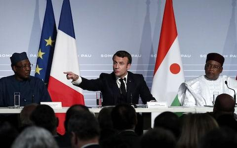 French President Emmanuel Macron (C) flanked by Niger's President in a press conference earlier this week - Credit: AFP