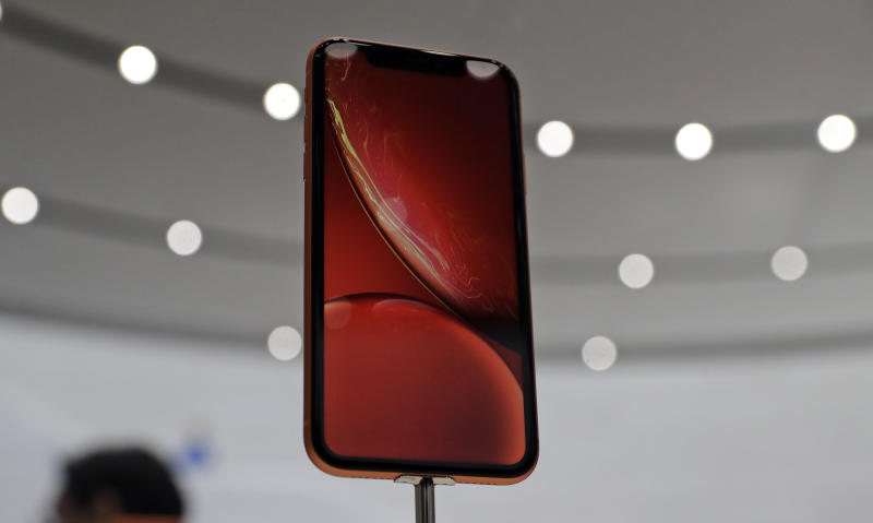 The new Apple iPhone XR is on display at the Steve Jobs Theater during an event to announce new products Wednesday, Sept. 12, 2018, in Cupertino, Calif. (AP Photo/Marcio Jose Sanchez)