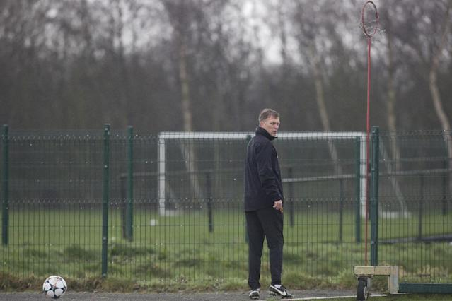 Manchester United's manager David Moyes walks between pitches as his team train at Carrington training ground in Manchester, Tuesday, March 18, 2014. Manchester United will play Olympiakos in a Champions League last 16 second leg soccer match on Wednesday. (AP Photo/Jon Super)