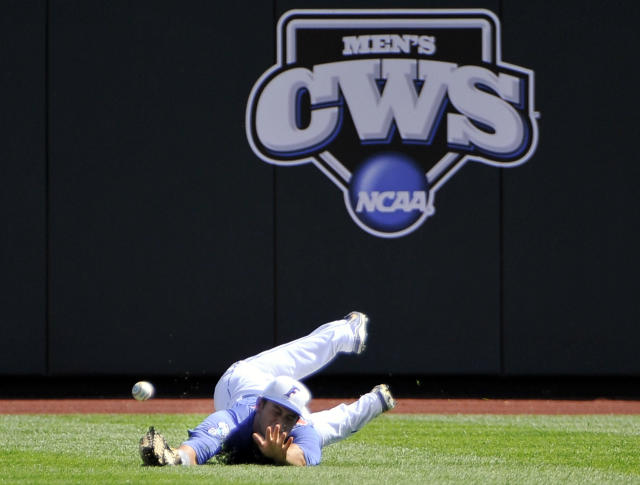 Florida right fielder Preston Tucker can't reach an RBI single by Kent State's George Roberts in the first inning of an NCAA College World Series elimination baseball game in Omaha, Neb., Monday, June 18, 2012. Jimmy Rider scored on the play. (AP Photo/Eric Francis)