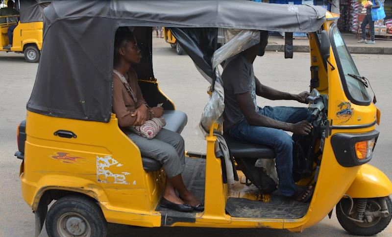 Cheap to run and safer than the traditional motorcycle taxi, the auto-rickshaw is an increasingly common sight trundling along the traffic-choked streets of the Africa's sprawling capitals (AFP Photo/Zoom Dosso)