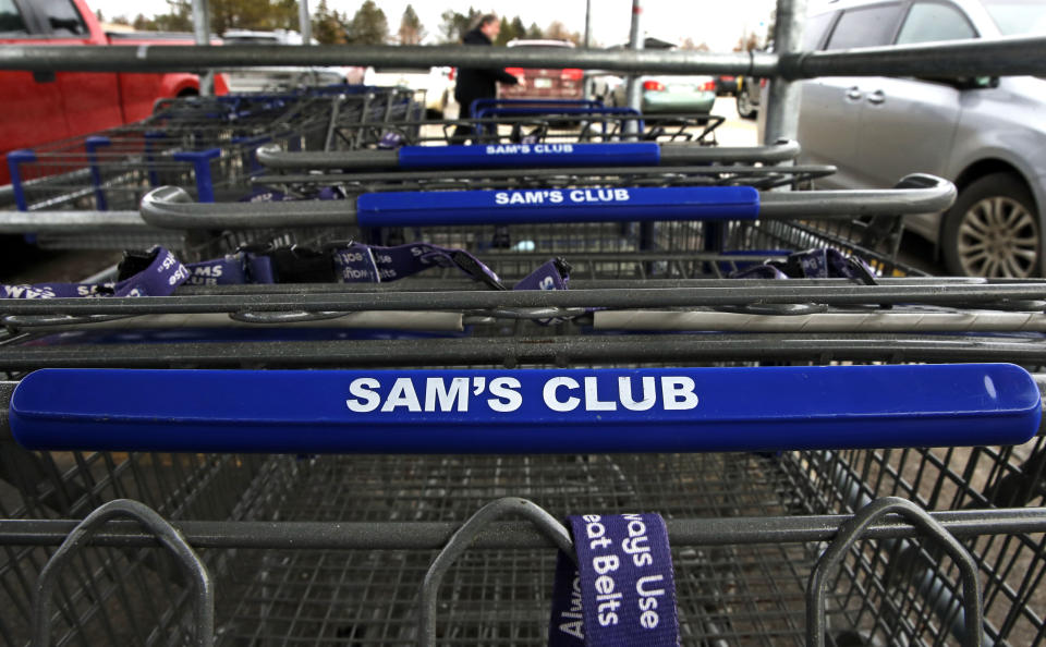 Shopping carts in a corral in the parking lot of a Sam's Club store in Concord, N.H., Friday, Feb. 23, 2018. (AP Photo/Charles Krupa)