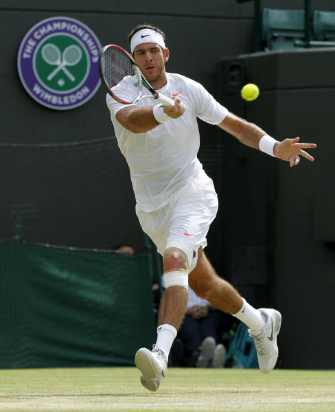 Juan Martin Del Potro of Argentina returns to Andreas Seppi of Italy during their Men's singles match at the All England Lawn Tennis Championships in Wimbledon, London, Monday, July 1, 2013. (AP Photo/Sang Tan)
