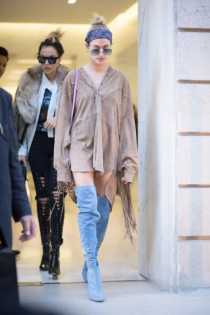 <p>Not the first time the young model has not bothered with bottoms. We almost witnessed a wardrobe malfunction during Paris fashion week when she stepped out in wearing only a pair of thigh-high boots and fringed top. <i>(Photo by Timur Emek/Getty Images)</i></p>