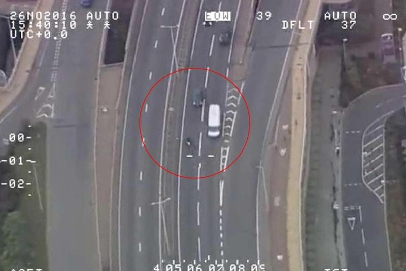 Police chase: A moped is seen being driven the wrong way down a dual carriageway