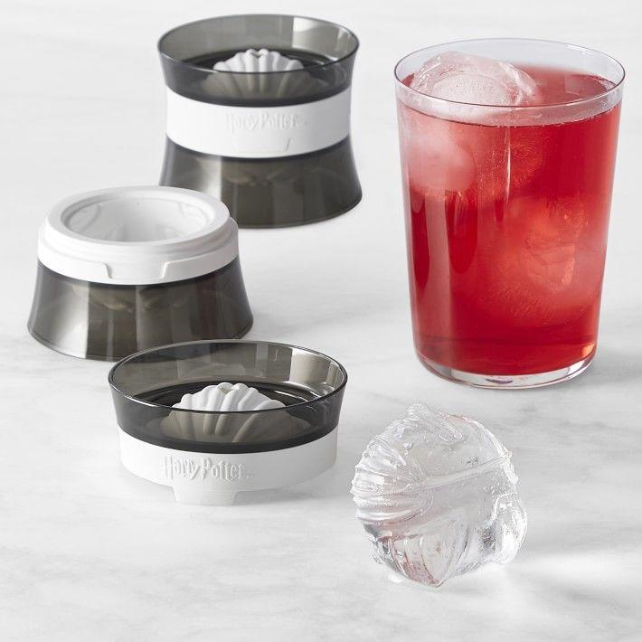"""<p>williams-sonoma.com</p><p><strong>$21.95</strong></p><p><a href=""""https://go.redirectingat.com?id=74968X1596630&url=https%3A%2F%2Fwww.williams-sonoma.com%2Fproducts%2Fharry-potter-snitch-ice-balls-set-of-2&sref=https%3A%2F%2Fwww.delish.com%2Fkitchen-tools%2Fg4511%2Fharry-potter-gifts%2F"""" rel=""""nofollow noopener"""" target=""""_blank"""" data-ylk=""""slk:BUY NOW"""" class=""""link rapid-noclick-resp"""">BUY NOW</a></p><p>Covet your drink even more with golden snitch ice balls.</p>"""