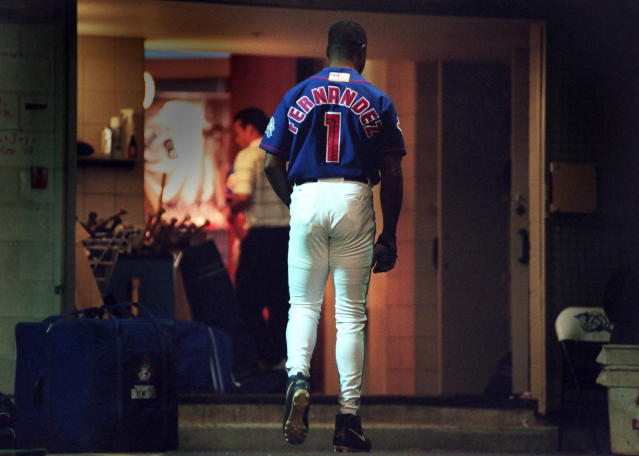 FILE - In this Oct. 7, 2001, file photo, Toronto Blue Jays' Tony Fernandez walks the tunnel to the clubhouse after pinch-hitting n the eighth inning against the Cleveland Indians in a baseball game in Toronto, his last game in the majors. Fernandez, a stylish shortstop who made five All-Star teams during his 17 seasons in the major leagues and helped the Toronto Blue Jays win the 1993 World Series, died Sunday, Feb. 16, 2020, after complications from a kidney disease. He was 57. (Fred Thornhill/The Canadian Press via AP, File)