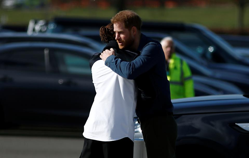 NORTHAMPTON, ENGLAND - MARCH 06: Prince Harry, Duke of Sussex embraces Formula One World Champion Lewis Hamilton as he officially opens The Silverstone Experience at Silverstone on March 6, 2020 in Northampton, England. (Photo by Peter Nicholls-WPA Pool/Getty Images)