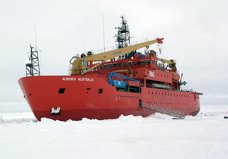 This handout photo provided by NSIDC, University of Colorado, taken in Oct. 2003, shows the icebreaker Aurora Australis awaiting the return of the scientific teams and their equipment in the Antarctic. The ice goes on seemingly forever in a white pancake-flat landscape, stretching so far it just set a record. And yet in this confounding region of the world, that spreading ice may be a cock-eyed signal of man-made climate change, scientists say. (AP Photo/NSIDC, University of Colorado)