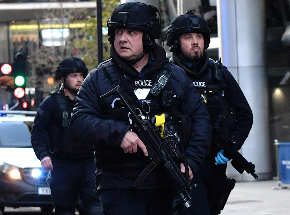 Armed police patrol along Cannon Street in central London, on November 29, 2019 after reports of shots being fired on London Bridge. - The Metropolitan Police on Friday said several people were injured and a man was held after a stabbing near London Bridge in the centre of the British capital. (Photo by Ben STANSALL / AFP) (Photo by BEN STANSALL/AFP via Getty Images)