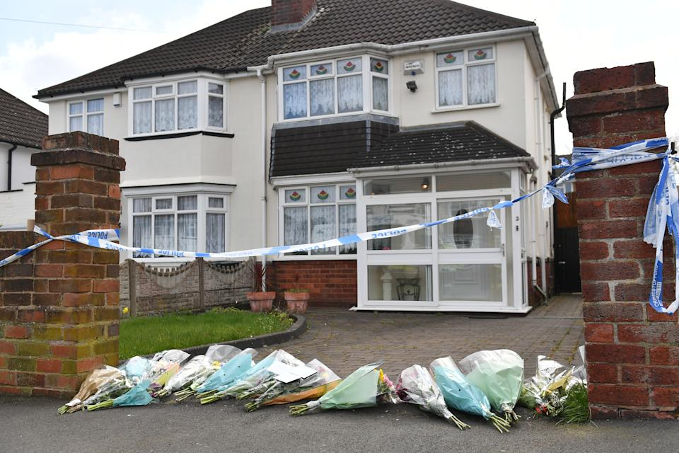 Flowers outside the house on Boundary Avenue in Rowley Regis, West Midlands, where a woman in her 80s died after being attacked by two escaped dogs. Picture date: Saturday April 3, 2021.