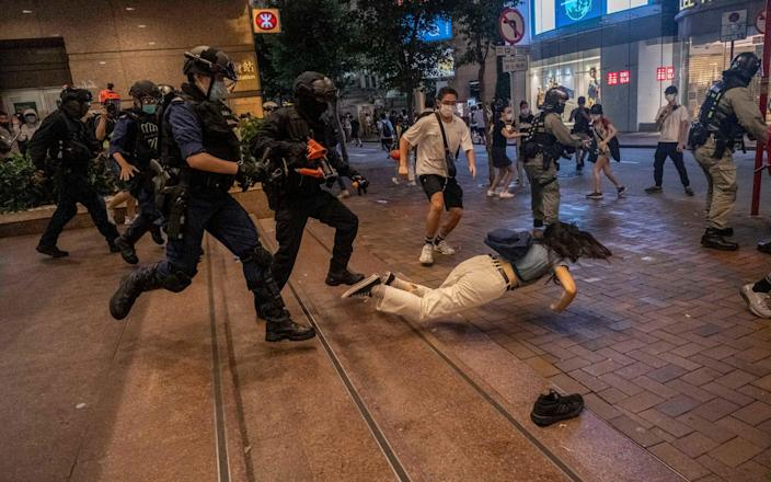 Police clash with protesters in Hong Kong on July 1 after the first arrests under China's new national security law as the city felt the chilling effect of Beijing's offensive to quash dissent in the territory - LAM YIK FEI/NYTNS / Redux / eyevine