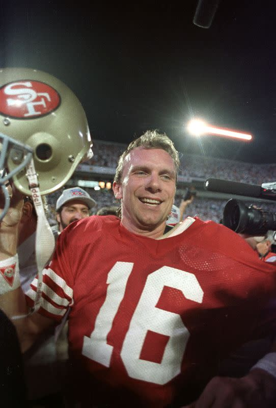 FILE PHOTO: JOE MONTANA CELEBRATES SUPER BOWL XXIII VICTORY AS HE LEAVES THE FIELD.